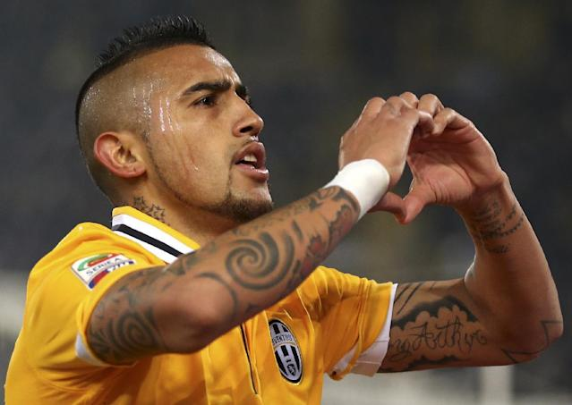 Juventus' Arturo Vidal celebrates after scoring during the Serie A soccer match between Bologna and Juventus at the Dall' Ara stadium in Bologna, Italy, Friday, Dec. 6, 2013. (AP Photo/Antonio Calanni)