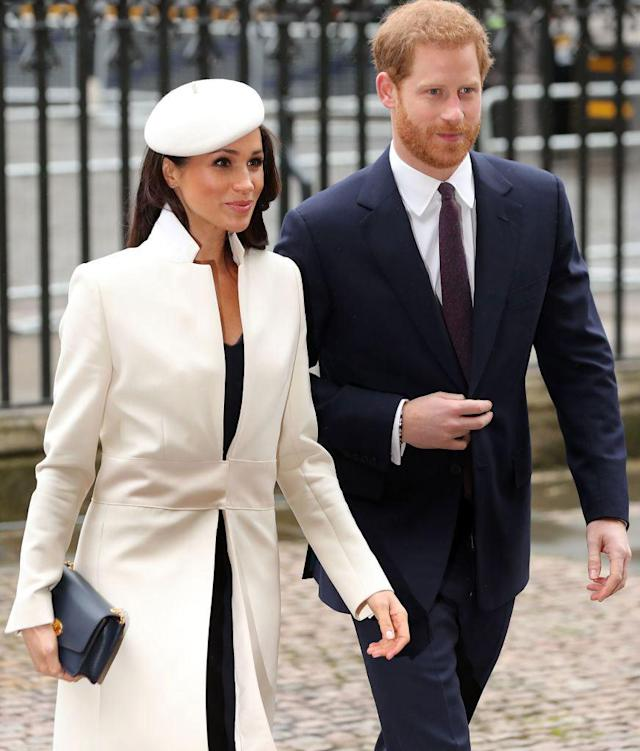 <p>Meghan wears a crisp white coat and fitted dress by Amanda Wakely to attend the Commonwealth Day service at Westminster Abbey. (Photo: Daniel Leal-Olivas/AFP/Getty Images) </p>