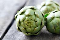 """<p>Another simple (but ultra gourmet-seeming) idea: steamed artichokes, which you can make quickly and mess-free in the <a href=""""https://www.goodhousekeeping.com/appliances/microwave-reviews/g2049/countertop-microwave-reviews/"""" rel=""""nofollow noopener"""" target=""""_blank"""" data-ylk=""""slk:microwave"""" class=""""link rapid-noclick-resp"""">microwave</a>. Flavor with lemon juice and seasoning, like salt and pepper or chili flakes. Then dunk into a hearty 1/3 cup of hummus or Greek yogurt-based dip.</p>"""