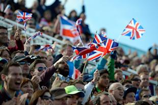 Fans like them might have money on the Olympics. (AP)