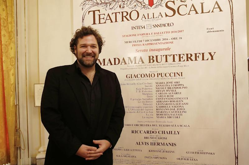 Tenor Bryan Hymel poses for photographers prior to the start of the press conference at the La Scala theater in Milan, Italy, Wednesday, Nov. 30, 2016. La Scala will open its season on Dec. 7 with Giacomo Puccini's Madama Butterfly. (AP Photo/Antonio Calanni)