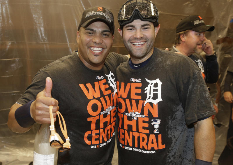 Detroit Tigers' Brayan Pena, left, and Alex Avila smile as they celebrate after the Tigers won the AL Central title with a 1-0 win over the Minnesota Twins in a baseball game, Wednesday, Sept. 25, 2013, in Minneapolis. (AP Photo/Jim Mone)