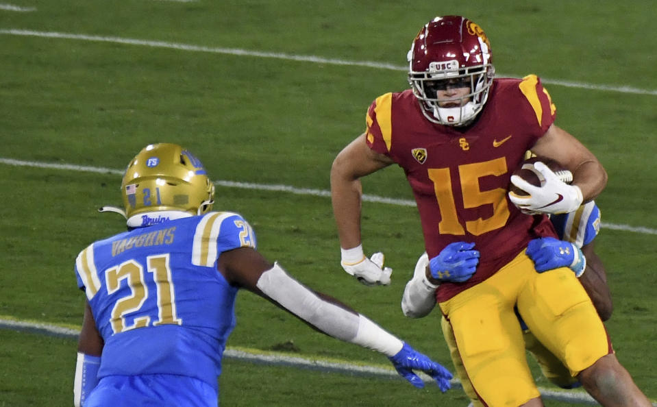 Wide receiver Drake London #15 of the USC Trojans catches a pass for yardage against the UCLA Bruins in the first half of a NCAA Football game at the Rose Bowl in Pasadena on Saturday, December 12, 2020. (Keith Birmingham/The Orange County Register via AP)