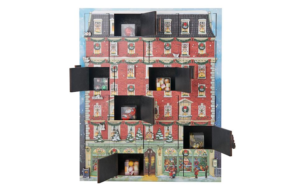 "<p>As well as a whole host of chocolates, this special wooden calendar also houses a bunch of sweets from Fortnum's confectionery counter. <br><a href=""https://www.fortnumandmason.com/products/fortnum-s-wooden-confectionery-advent-calendar?taxon_id=695"" rel=""nofollow noopener"" target=""_blank"" data-ylk=""slk:Fortnum & Mason, £125"" class=""link rapid-noclick-resp""><i>Fortnum & Mason, £125</i></a> </p>"