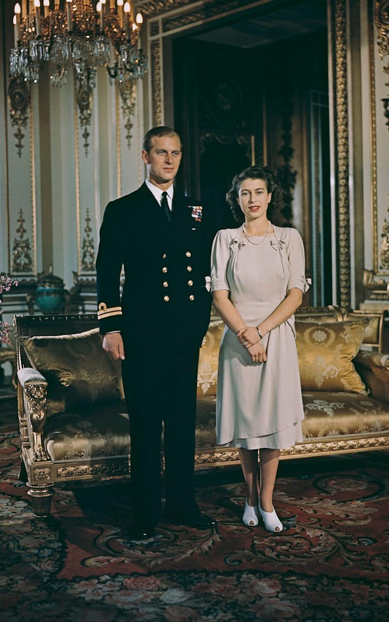 Princess Elizabeth (later Queen Elizabeth II) and her betrothed, Lieutenant Philip Mountbatten (later Duke of Edinburgh) pose together at Buckingham Palace in London after announcing their engagement on 10th July 1947. - Credit: Rolls Press/Popperfoto