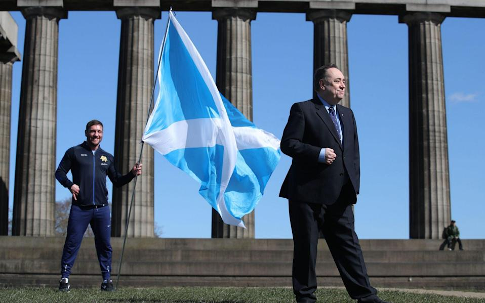Alex Salmond (right) with former boxer and Alba Lothian candidate Alex Arthur at a photocall on Calton Hill, Edinburgh - PA