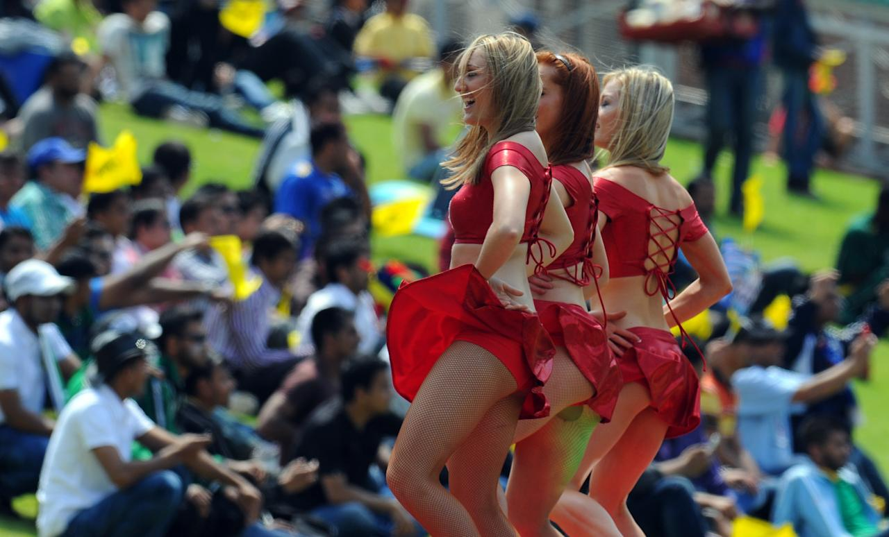 Cheerleaders perform during a Group B match of the Champions League T20 (CLT20) between the Chennal Super Kings and the Sydney Sixers at the Wanderers Stadium in Johannesburg on October 14, 2012.  AFP PHOTO / ALEXANDER JOE