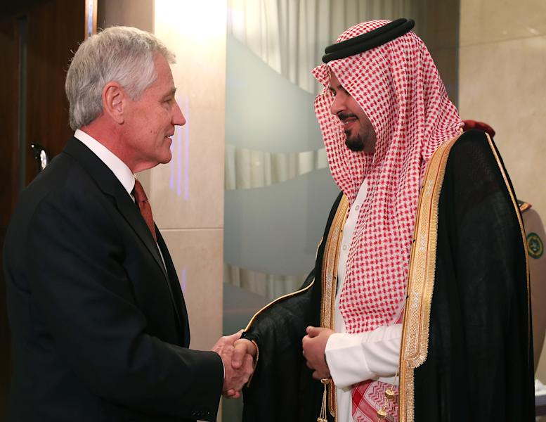 U.S. Secretary of Defense Chuck Hagel, left, greets Saudi Arabia Deputy Minister of Defense Prince Salman bin Sultan, before a meeting at the Radisson Hotel, on Friday, Dec. 6, 2013 in Manama, Bahrain. Secretary Hagel is visiting Bahrain while on a six day trip to the middle east, and is scheduled to speak at the Manama Dialogue Regional Security Summit tomorrow. (AP Photo/Mark Wilson, Pool)
