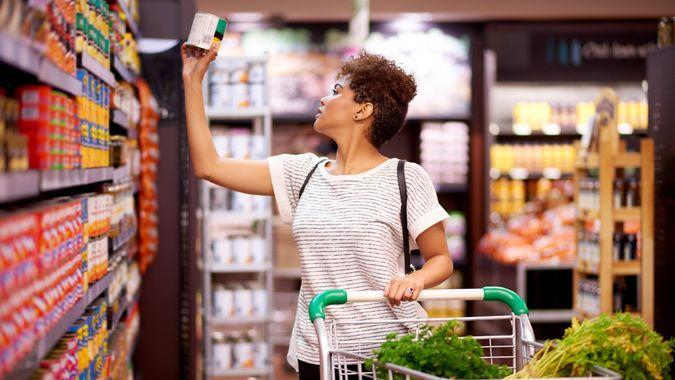Shot of a young woman shopping in a grocery store.