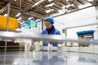 Ecolab employees on the filling line prepare the Skinman Soft Protect FF virucidal hand rub that is supplied to the NHS