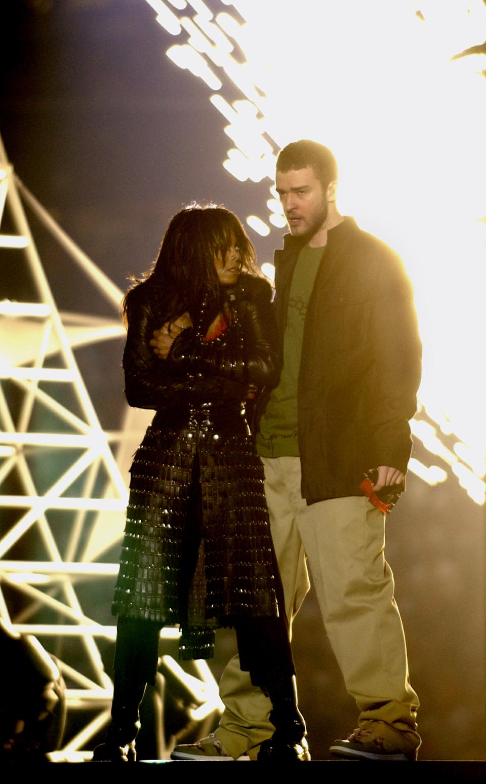 Janet Jackson covers her breast after her outfit came undone during a number with Justin Timberlake during the halftime show of Super Bowl