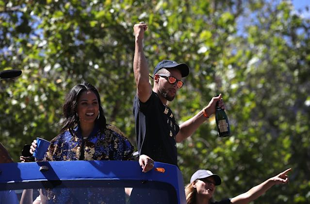 <p>Golden State Warriors Stephen Curry (R) and his wife Ayesha Curry (L) greet fans during the Warriors Victory Parade on June 15, 2017 in Oakland, California. An estimated crowd of over 1 million people came out to cheer on the Golden State Warriors during their victory parade after winning the 2017 NBA Championship. (Photo by Justin Sullivan/Getty Images) </p>