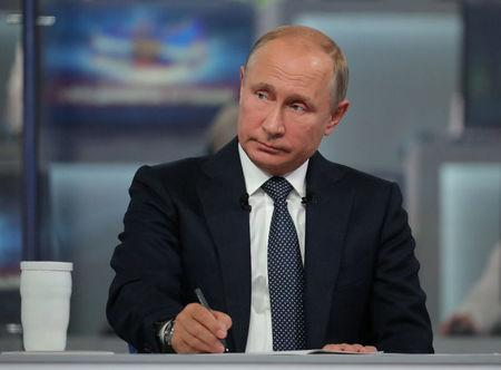 Russian President Putin attends a live nationwide broadcast call-in in Moscow