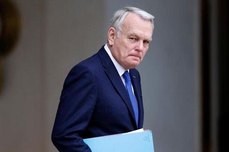 French Foreign Affairs Minister Jean-Marc Ayrault  leaves the Elysee Palace in Paris following the weekly cabinet meeting