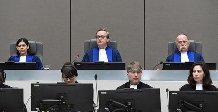 Presiding Judge Marc Perrin de Brichambaut, Judge Olga Herrera-Carbuccia, and Judge Peter Kovacs in the courtroom of the ICC as it delivers its order for reparations to victims in the case The Prosecutor v. Germain Katanga at a public hearing, in The Hague