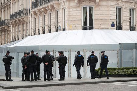 """French gendarmes and riot police officers secure the Champs-Elysees avenue in front of the famed restaurant Fouquet's during the Act XIX (the 19th consecutive national protest on a Saturday) of the """"yellow vests"""" movement in Paris, France, March 23, 2019. REUTERS/Benoit Tessier"""