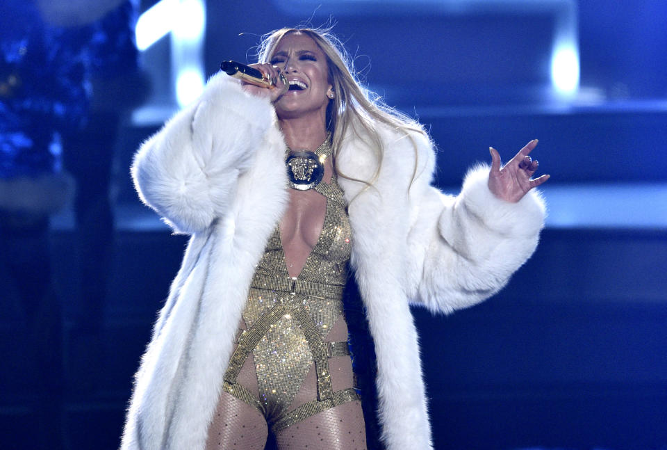 "FILE - Video Vanguard award recipient Jennifer Lopez performs at the MTV Video Music Awards in New York on Aug. 20, 2018. Lopez will help bring in the New Year with a headlining performance in New York's Time Square for ""Dick Clark's New Year's Rockin' Eve with Ryan Seacrest 2021."" ABC and dick clark productions announced Tuesday that the pop star will perform live before the icon ball drop on Dec. 31. Because of the coronavirus pandemic, the event will be closed to the public. (Photo by Chris Pizzello/Invision/AP, File)"