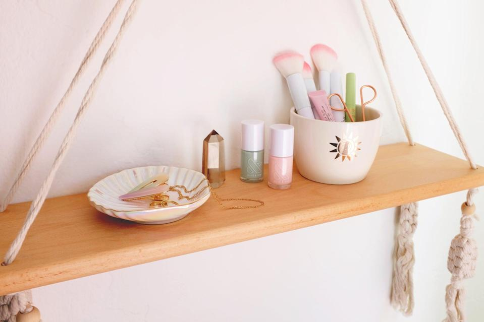 <p>Create a vanity space for getting ready in the morning with a small dish for jewelry and accessories and a stylish bowl for makeup brushes. Add a crystal for flair.</p>