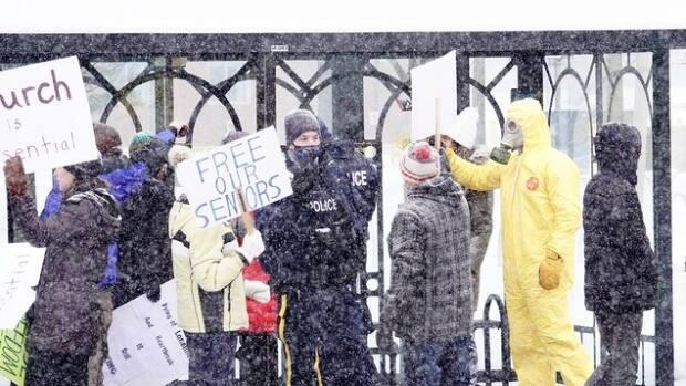 Five people were charged after a protest in Moncton in January against measures meant to limit the spread of COVID-19. (Guy LeBlanc/Radio-Canada - image credit)