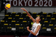 United States' Jordan Thompson throws a spike during the women's volleyball preliminary round pool B match between China and United States at the 2020 Summer Olympics, Tuesday, July 27, 2021, in Tokyo, Japan. (AP Photo/Frank Augstein)