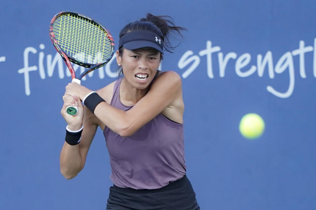 Hsieh Su-Wei of Chinese Taipei, returns to Naomi Osaka, of Japan, during the quarterfinals of the Western & Southern Open tennis tournament, Thursday, Aug. 15, 2019, in Mason, Ohio. (AP Photo/John Minchillo)