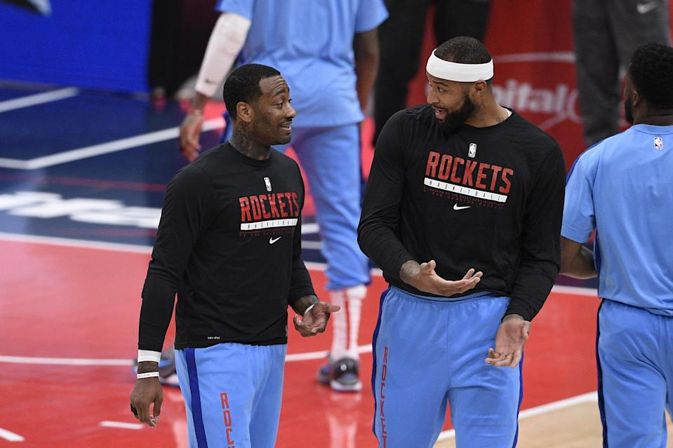 Houston Rockets guard John Wall, left, talks with center DeMarcus Cousins, right, before an NBA basketball game against the Washington Wizards, Monday, Feb. 15, 2021, in Washington. (AP Photo/Nick Wass)