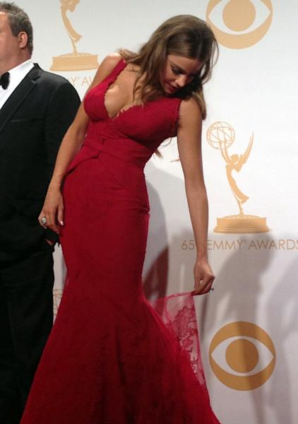 Sofia Vergara examines her ripped dress backstage at the 65th Primetime Emmy Awards at Nokia Theatre on Sunday Sept. 22, 2013, in Los Angeles. (AP Photo/Caryn Rousseau)