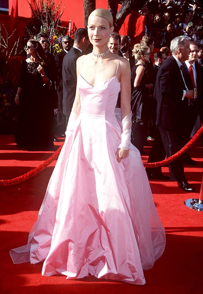 """Two months later, Paltrow donned a pink Ralph Lauren gown for the Oscars as she took home an Academy Award for her lead role in """"Shakespeare in Love."""" The garment has since become as iconic as Jennifer Lopez's green Versace dress from the 2000 Grammy Awards or Marilyn Monroe's white dress from """"Some Like It Hot."""" (3/21/1999)"""