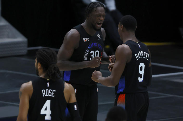 Julius Randle (30) and RJ Barrett are two big reasons for the Knicks' resurgence this season. (Photo by Tom Pennington/Getty Images)