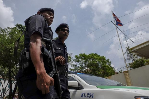 Malaysian police stand guard in front of the North Korean embassy in Damansara Heights, Kuala Lumpur after the government imposed a ban on its diplomats from leaving the country on March 7, 2017.
