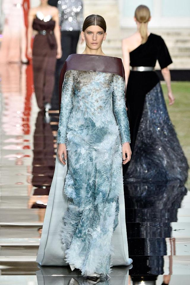 <p>Model wears a long-sleeve blue feathered gown and cape from the Givenchy fall 2018 couture collection. (Photo: Getty Images) </p>