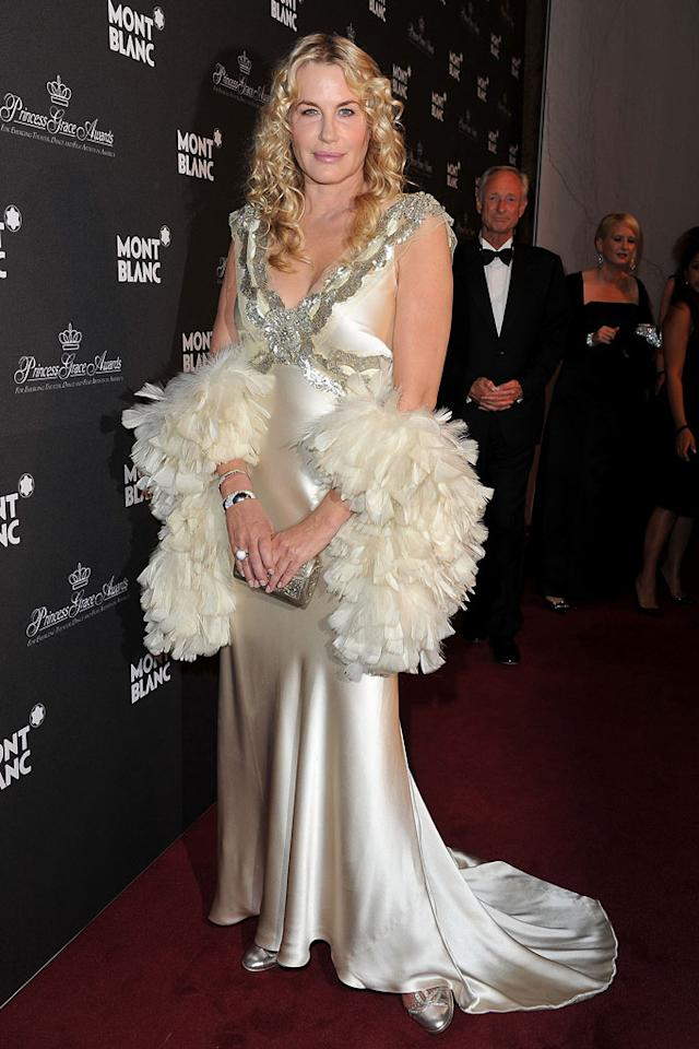 "Last week, environmentalist Daryl Hannah was arrested while protesting in front of the White House. This week, the ""Splash"" star is getting slapped with a citation from the omg! fashion police for the chintzy cream gown and feather boa she donned to to a soiree in Monte Carlo. What was she thinking?! Pascal Le Segretain/<a href=""http://www.gettyimages.com/"" target=""new"">GettyImages.com</a> - September 8, 2011"