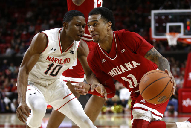 Indiana guard Devonte Green, right, drives around Maryland guard Serrel Smith Jr. in the first half of an NCAA college basketball game, Friday, Jan. 11, 2019, in College Park, Md. (AP Photo/Patrick Semansky)
