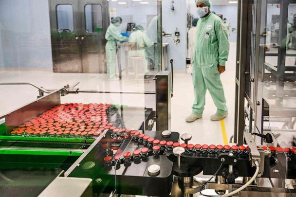 PHOTO: In this Sept. 11, 2020, file photo, a lab tech supervises capped vials during filling and packaging tests for the large-scale production and supply of the University of Oxfords COVID-19 vaccine candidate, AZD1222, in Anagni, Italy. (Vincenzo Pinto/AFP via Getty Images, FILE)