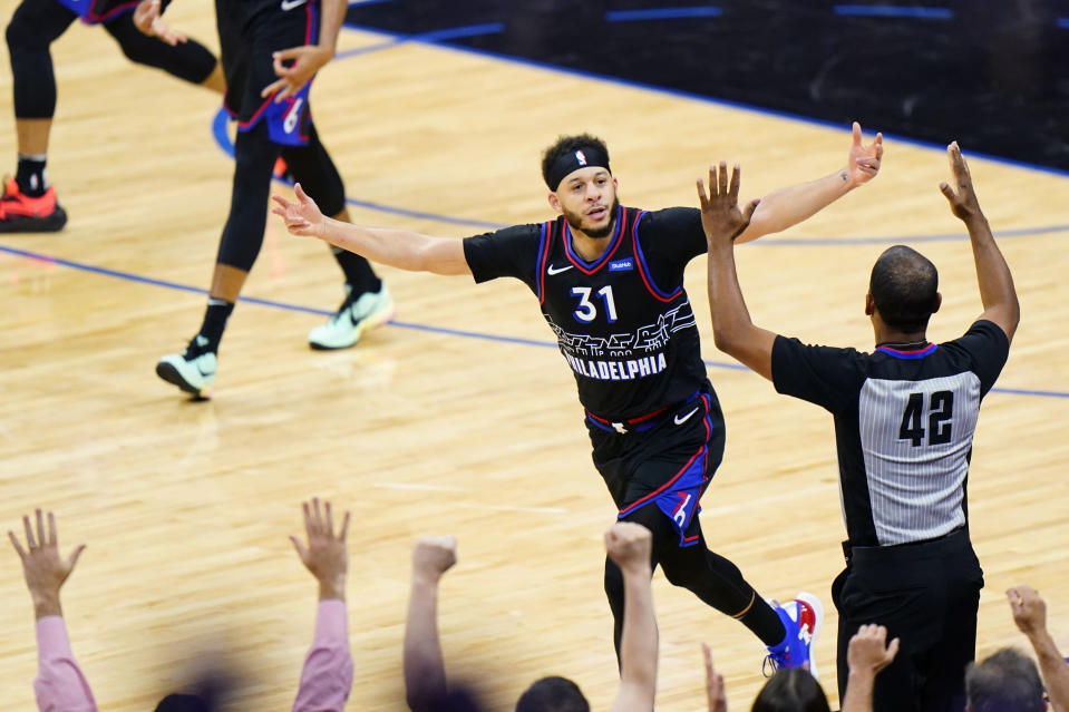 Philadelphia 76ers' Seth Curry reacts after making a three-pointer during the second half of Game 1 of a first-round NBA basketball playoff series against the Washington Wizards, Sunday, May 23, 2021, in Philadelphia. (AP Photo/Matt Slocum)