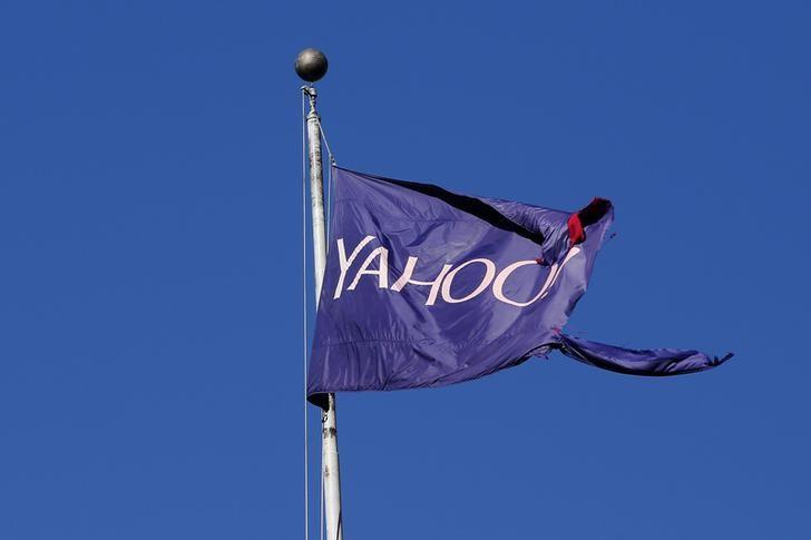 FILE PHOTO: A tattered flag bearing the Yahoo company logo flies above a building in New York