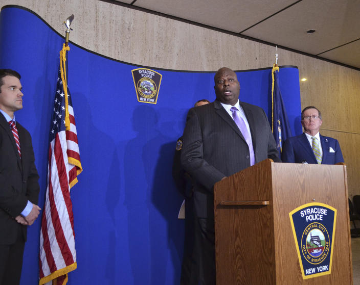 Syracuse Police Chief Kenton T. Buckner, center, speaks during a news conference about Syracuse men's basketball coach Jim Boeheim, Thursday, Feb. 21, 2019, in Syracuse, N.Y. Boeheim struck and killed a man along an interstate late Wednesday night as he tried to avoid hitting the man's disabled vehicle, police say. (AP Photo/Nick Lisi)