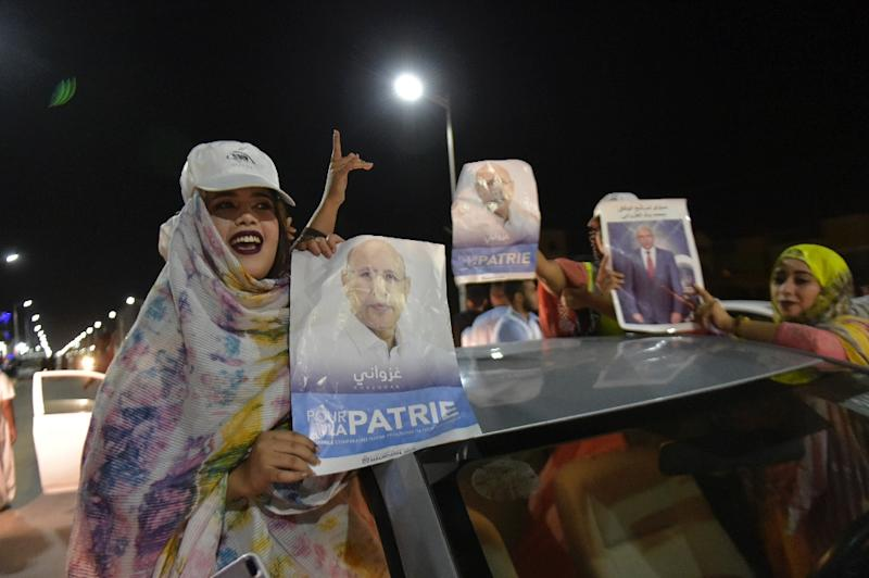 Supporters celebrated Mohamed Ould Ghazouani's victory in Mauritania's presidential election which is set to be the first democratic transfer of power in the country (AFP Photo/Sia KAMBOU)