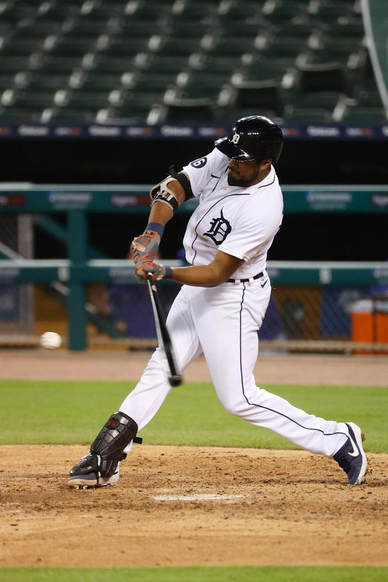 Detroit Tigers third baseman Jeimer Candelario (46) hits a single in the fifth inning against the Kansas City Royals at Comerica Park.