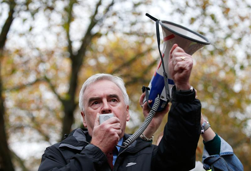 Britain's Shadow Chancellor of the Exchequer John McDonnell of the opposition labour Party speaks through a loud hailer at the start of a march by students protesting against cuts to grants, in London, November 4, 2015. REUTERS/Peter Nicholls