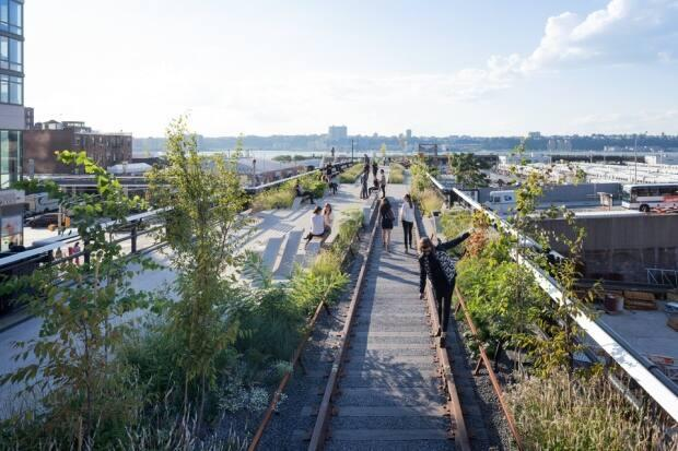 New York's massively popular High Line Park weaves its way between Manhattan's West Side towers on a converted elevated train track.