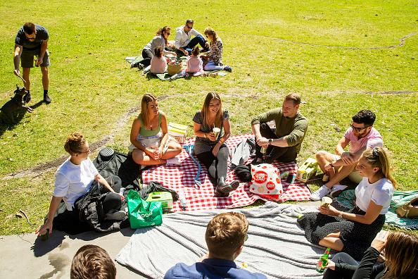 People are seen during a picnic in Centennial Park in Sydney, Australia.