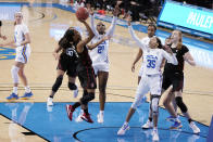Stanford guard Kiana Williams, front left, shoots over UCLA forward Michaela Onyenwere (21) and guard Camryn Brown (35) during the first half of an NCAA college basketball game Monday, Dec. 21, 2020, in Los Angeles. (AP Photo/Marcio Jose Sanchez)