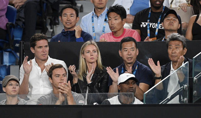 Supporters of Japan's Naomi Osaka cheer her on during her match against Petra Kvitova of the Czech Republic in the women's singles final at the Australian Open tennis championships in Melbourne, Australia, Saturday, Jan. 26, 2019. (AP Photo/Andy Brownbill)