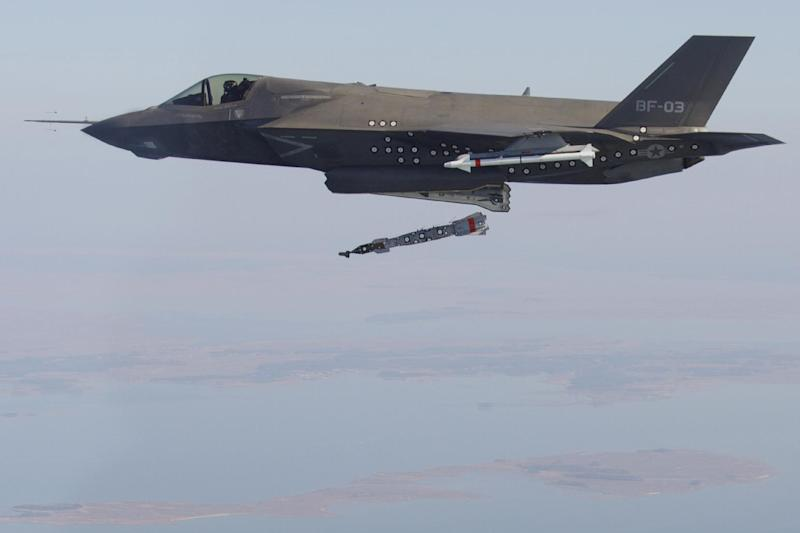 An F-35B test aircraft BF-03, flown by Lt. Cmdr. Michael Burks, completes the first aerial weapons release of an inert 500-pound GBU-12 on December 3, 2012