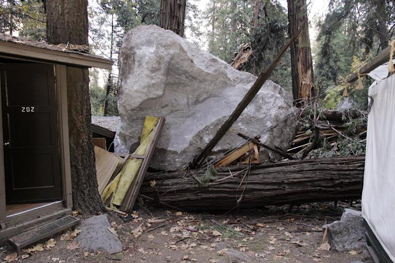 FILE - In this Monday, Oct. 20, 2008 file photo, a boulder sits atop debris after it fell in Curry Village in Yosemite National Park, Calif. Falling boulders are the single biggest force shaping Yosemite Valley, one of the most popular tourist destinations in the national park system. Now swaths of some popular haunts are closing for good after geologists confirmed that unsuspecting tourists and employees are being lodged in harm's way. On Thursday, June 13, 2012, the National Park Service will announce that potential danger from the unstable 3,000-foot-tall Glacier Point, a granite promontory that for decades has provided a dramatic backdrop to park events, will leave some of the valley's most popular lodging areas permanently uninhabitable. (AP Photo/Paul Sakuma, File)