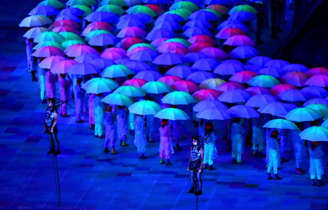 LONDON, ENGLAND - AUGUST 29: Artists perform with umbrellas during the Opening Ceremony of the London 2012 Paralympics at the Olympic Stadium on August 29, 2012 in London, England. (Photo by Mike Ehrmann/Getty Images)