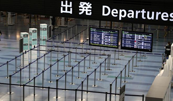 Departure gates sit empty at Haneda Airport in Tokyo. Photo: Reuters
