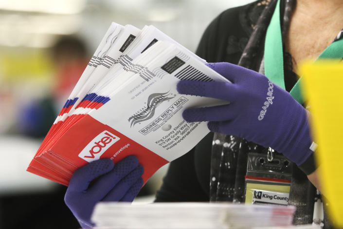 An election workers sorts vote-by-mail ballots for the presidential primary at King County Elections in Renton, Washington on March 10, 2020. (Jason Redmond/AFP via Getty Images)