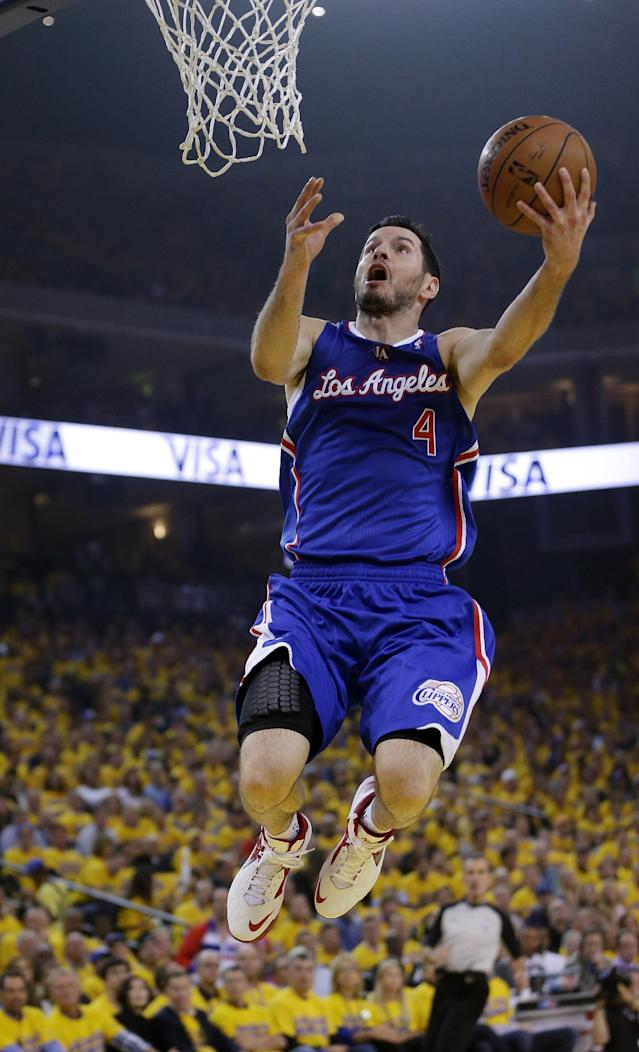 Los Angeles Clippers' J.J. Redick scores on a breakaway layup against the Golden State Warriors during the first half in Game 3 of an opening-round NBA basketball playoff series, Thursday, April 24, 2014, in Oakland, Calif. (AP Photo/Marcio Jose Sanchez)